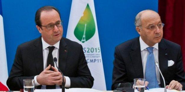 Le président français François Hollande et le ministre des Affaires étrangères Laurent Fabius