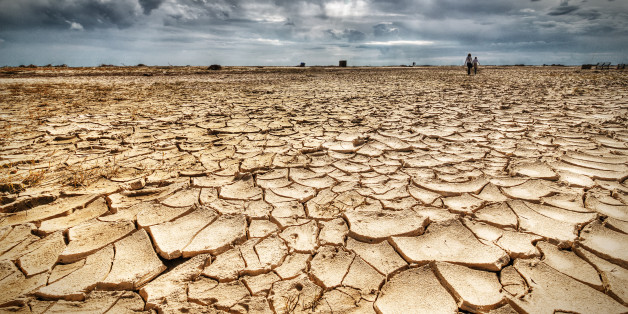 Woman and girl walking on drought.