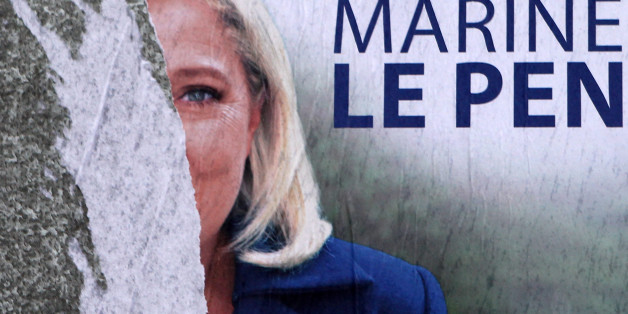 A torn poster of French far-right party leader Marine Le Pen is seen in Henin-Beaumont, northern France, Friday, Dec. 11, 2015.  Le Pen is in the race for the presidency of the French northern region. The second round of the regional elections will take place Sunday. (AP Photo/Michel Spingler)