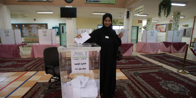 JEDDAH, SAUDI ARABIA- DECEMBER 12:  A Saudi woman casts her vote for the municipal elections at a polling station on December 12, 2015 in Jeddah, Saudi Arabia. Saudi Women are running the municipal council seats as candidates for the first time in the Kingdom's history and also be allowed for the first time to vote in a governmental election. The Municipal councils are the only government body in which Saudi Arabian citizens can elect representatives, so the vote is widely seen as a small but significant opening for women to play a more equal role in society.  (Photo by Jordan Pix/ Getty Images)