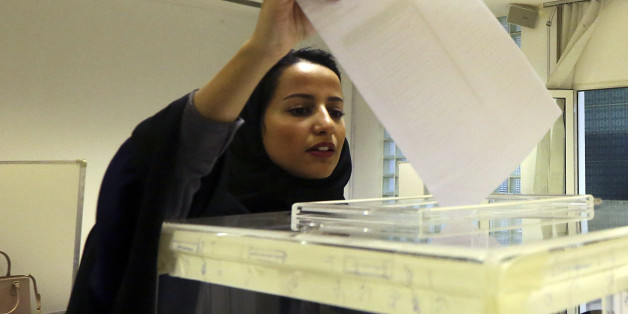 A Saudi woman casts her ballot at a polling center during municipal elections in Riyadh, Saudi Arabia, Saturday, Dec. 12, 2015. Saudi women are heading to polling stations across the kingdom on Saturday, both as voters and candidates for the first time in this landmark election. (AP Photo/Aya Batrawy)