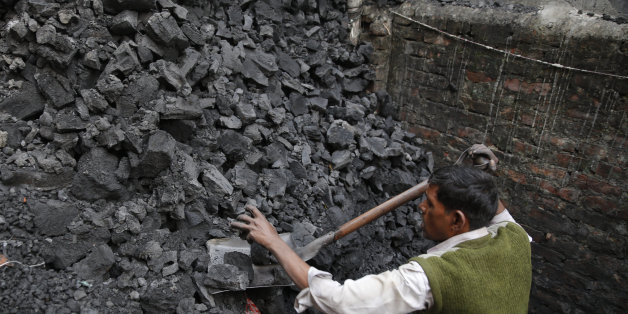 An Indian coal worker prepares to weigh  coal in Lucknow, India, Thursday, Dec. 3, 2015. An Indian delegate at U.N. climate talks says India will be able cut back on its carbon emissions if money is made available to boost renewable energy in an envisioned climate agreement in Paris.India's negotiators want to make sure that any deal in Paris doesn't restrict India's ability to expand its economy and electricity access to about 300 million people who currently have none. That means it's hard for
