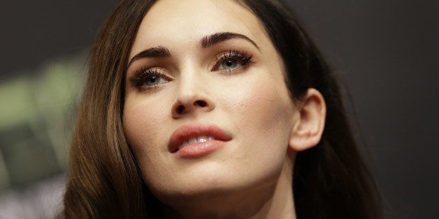 "Megan Fox listens to reporters' question during a press conference for her latest film ""Teenage Mutant Ninja Turtles"" in Seoul, South Korea, Wednesday, Aug. 27, 2014. The movie is to be released in South Korea on Aug. 28. (AP Photo/Lee Jin-man)"