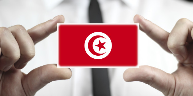 Businessman holding a business card with Tunisia Flag