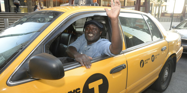 Taxi driver Frederick Amoafo, named the safest taxi driver in New York by the Taxi and Limousine Commission on Tuesday, August 26, 2014. Amoafo has taken more than 50,000 passengers over 190,000 miles over the past five years without a single accident. (Photo By: Jefferson Siegel/NY Daily News via Getty Images)