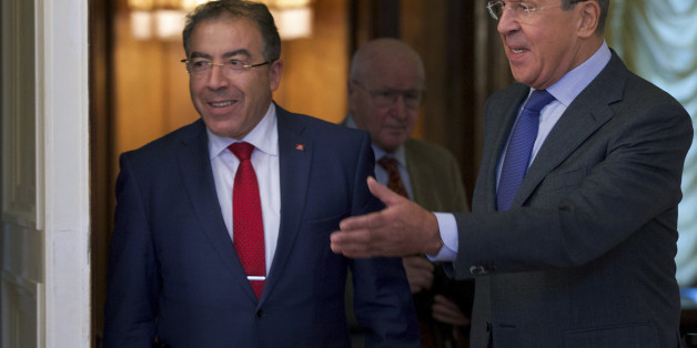 Russian Foreign Minister Sergey Lavrov, right, welcomes his Tunisian counterpart Mongi Hamdi during their talks in Moscow, Russia, Tuesday, Sept. 2, 2014. (AP Photo/Ivan Sekretarev)