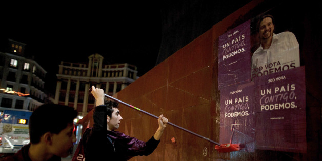 MADRID, SPAIN - DECEMBER 18:  Podemos (We Can) party supporters put up electoral campaign posters along the street hours before the campaign ends at the Madrid Wax Museum on December 18, 2015 in Madrid, Spain. Over 36 million Spaniards will flock to the polls on Sunday December 20, 2015 to vote for 350 members of the parliament and 208 senators. For the first time since 1982, the two traditional Spanish political parties, right-wing Partido Popula (People's Party) and centre-left wing Partido Socialista Obrero Espanol PSOE (Spanish Socialist Workers' Party), are holding a tight election race with two new contenders, Ciudadanos (Citizens) and Podemos (We Can) attracting right-leaning and left-leaning voters respectively.  (Photo by Pablo Blazquez Dominguez/Getty Images)