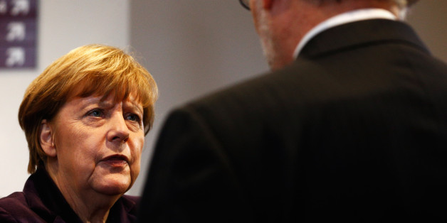 BRUSSELS, BELGIUM - DECEMBER 17:  Chancellor of Germany, Angela Merkel speaks to the Prime Minister of Spain, Mariano Rajoy Brey during the family photo opportunity at  The European Council Meeting In Brussels held at the Justus Lipsius Building on December 17, 2015 in Brussels, Belgium.  European leaders are meeting to discuss David Camerons proposed EU reforms, as well as focussing on the migrant crisis, the fight against terrorism and climate change.  (Photo by Dean Mouhtaropoulos/Getty Images)