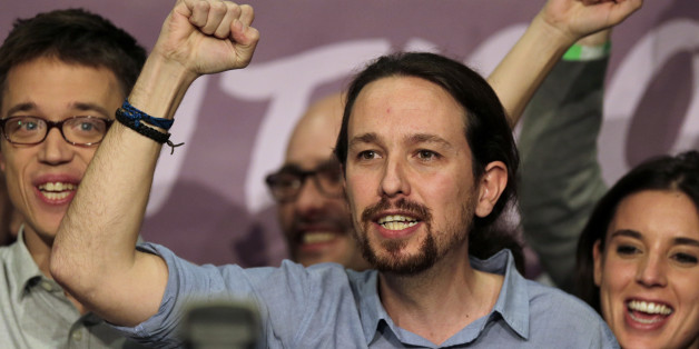 Podemos party leader Pablo Iglesias, center, celebrates next to other party leaders  following the latest official results in Madrid, Sunday, Dec. 20, 2015. Podemos supporters gathered outside their party headquarters in Madrid cheering as general election results began to roll in confirming the newcomer on the political scene looked set to capture 68 seats and a chance of forming a coalition in parliament.(AP Photo/Emilio Morenatti)