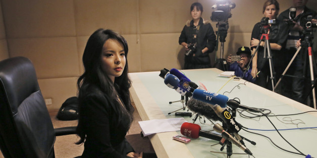 Canada's Miss World contestant Anastasia Lin speaks to media after she was denied entry to mainland China, at Hong Kong International Airport in Hong Kong, Friday, Nov. 27, 2015. Canada's outspoken Miss World contestant said she was barred Thursday from entering China to take part in this year's pageant and accused Beijing of overreach in extending its campaign of censorship even to beauty contests. (AP Photo/Vincent Yu)