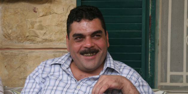 Samir Kuntar greets visitors on July 19, 2008, at his family home in Aabey, Lebanon. Kuntar spent nearly 30 years in an Israeli prison before being released on July 16, 2008, in a deal with Hezbollah.  (Photo by Dion Nissenbaum/MCT/MCT via Getty Images)