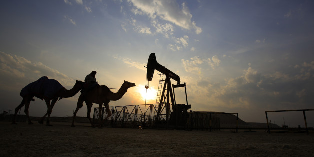 A man rides a camel through the desert oil field and winter camping area of Sakhir, Bahrain, Sunday, Dec. 20, 2015. Many Bahrainis head out to the desert during their free time in the winter months, enjoying picnics and socializing. (AP Photo/Hasan Jamali)