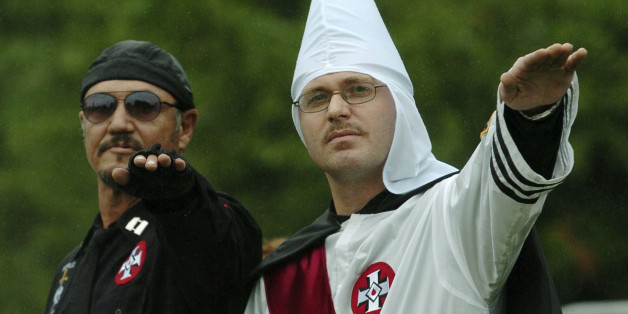 Members of the World Order of the Ku Klux Klan give a salute during a protest rally at the Gettysburg National Military Park Saturday, Sept. 2, 2006 in Gettysburg, Pa. The KKK fielded 25 members for the event and their were no incidents. (AP Photo/Bradley C Bower)