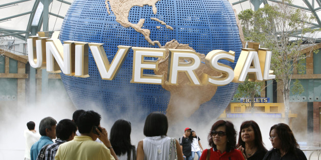 Crowds of people are seen in front of the Universal Studio globe during a media preview at the Universal Studios Singapore, Southeast Asia's first and only at Resorts World Sentosa, a recently opened integrated resort, on Tuesday March 16, 2010 in Singapore.(AP Photo/Wong Maye-E)