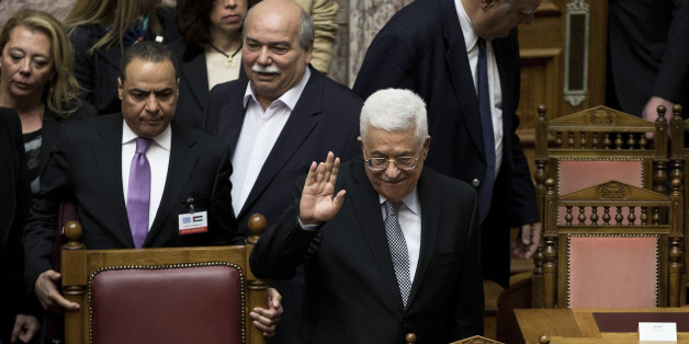 Palestinian President Mahmoud Abbas, waves to Greek lawmakers during his arrival at the Greek parliament in Athens , on Tuesday, Dec. 22, 2015. Greek lawmakers have unanimously approved a resolution calling on the country's left-led government to formally recognize Palestinian statehood.(AP Photo/Petros Giannakouris)