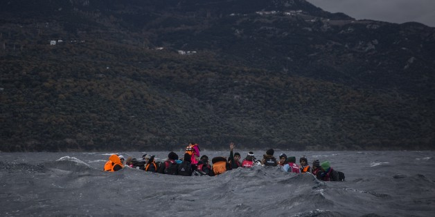 Refugees and migrants on a dinghy approaching the Greek island of Lesbos on Thursday, Dec. 17, 2015. According to the International Organization for Migration, more than 920,000 people have entered the EU so far this year. The influx has overwhelmed national border guards and reception capacities, notably in Greece, where some 770,000 migrants have arrived, most of them from Turkey. (AP Photo/Santi Palacios)