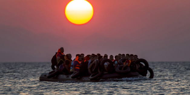 FOR USE AS DESIRED, YEAR END PHOTOS - FILE - Migrants on a dinghy arrives at the southeastern island of Kos, Greece, after crossing from Turkey, Thursday, Aug. 13, 2015. Greece has become the main gateway to Europe for tens of thousands of refugees and economic migrants, mainly Syrians fleeing war, as fighting in Libya has made the alternative route from north Africa to Italy increasingly dangerous. (AP Photo/Alexander Zemlianichenko, File)