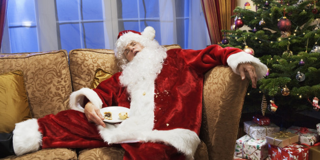 Father christmas is sleeping on sofa.