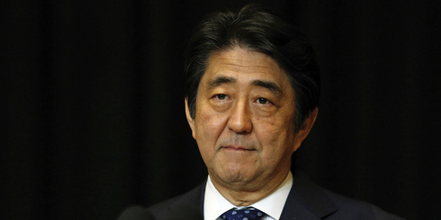 Japanese Prime Minister Shinzo Abe pauses during a press conference in Kuala Lumpur, Malaysia, Sunday, Nov. 22, 2015. (AP Photo/Lai Seng Sin)