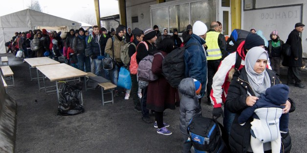 Migrants line up at transit area between Austria and Slovenia at border crossing in Spielfeld, Austria on December 9, 2015. Austria has begun to build a 3,7 km long fence to regulate migrants around the border crossing. AFP PHOTO / JOE KLAMAR / AFP / JOE KLAMAR        (Photo credit should read JOE KLAMAR/AFP/Getty Images)