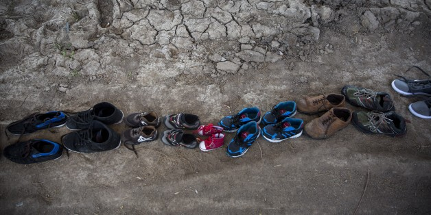 Shoes used by refugees when crossing the Aegean sea from Turkey to Greece remain drying up on a beach, on the island of Lesbos, on Thursday, Dec. 24, 2015.The Geneva-based International Organization for Migrants says more than 1 million people have entered Europe as of Monday. Almost all came by sea, while 3,692 drowned in the attempt.(AP Photo/Santi Palacios)