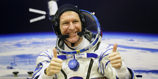 British astronaut Tim Peake gives a thumbs-up during suit pressure testing at the Baikonur Cosmodrome in Kazakhstan, ahead of his trip to the International Space Station. Picture date: Tuesday December 15 2015. Photo credit should read: Gareth Fuller/PA Wire