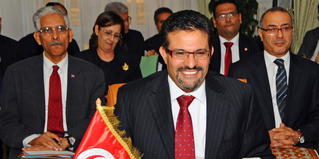 Tunisian Foreign Minister Rafik Abdessalem attends a meeting with his Egyptian and Libyan counterparts, in Tunis, Tunisia, Friday March 16, 2012. (AP Photo/Hassene Dridi)