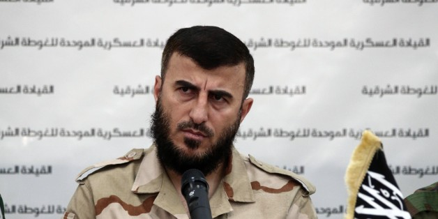 Zahran Alloush, the leader of Jaysh al-Islam (Islam Army) and military leader of the Islamic Front, attends a press conference with other brigade leaders in the rebel-held Eastern Ghouta region outside the capital Damascus on August 27, 2014, to announce the fomation of 'The Unified Military Command of Eastern Ghouta'. The unified command consists of Ajnad al-Sham (Soldiers of the Levant), the Islam army, Ahrar ash-Sham and Rahman brigade. AFP PHOTO/ABD DOUMANY        (Photo credit should read ABD DOUMANY/AFP/Getty Images)