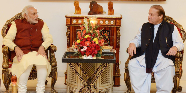 In this photo released by Press Information Department, Pakistan's Prime Minister Nawaz Sharif, right, meets Indian counterpart Narendra Modi in Lahore, Pakistan, Friday, Dec. 25, 2015. Modi arrived in Pakistan on Friday, his first visit as prime minister to this Islamic nation that has been India's long-standing archrival in the region. (Press Information Department via AP)