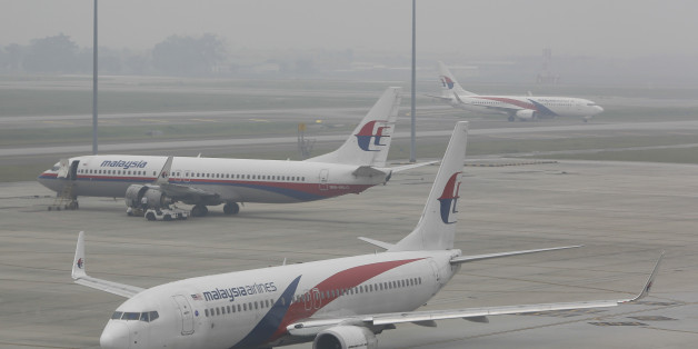 A fleet of Malaysia Airline planes are shrouded in haze at the Kuala Lumpur International Airport in Sepang, Malaysia on Sunday, Sept. 27, 2015. Wildfires caused by illegal land clearing in Indonesia's Sumatra and Borneo islands often spread choking haze to neighboring countries such as Malaysia and Singapore. (AP Photo/Joshua Paul)