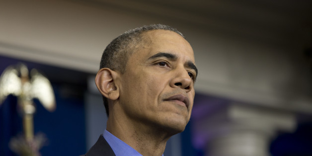 President Barack Obama pauses to listen to question during a news conference in the briefing room at the White House, in Washington, Friday, Dec. 18, 2015. (AP Photo/Carolyn Kaster)