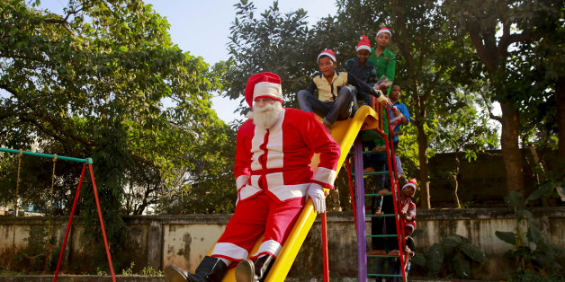 Bollywood actor Brandon Hill dressed as Santa Claus plays with underprivileged children at a Christmas party organized by a social organization in Mumbai, India, Tuesday, Dec. 22, 2015. Though Hindus and Muslims comprise the majority of the population in India, Christmas is celebrated with much fanfare. (AP Photo/Rafiq Maqbool)
