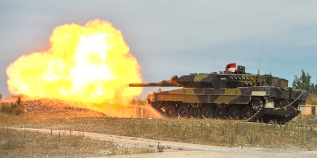 A Royal Danish Army Leopard 2 tank fires at a target during a live-fire exercise at the 7th Army Joint Multinational Training Command's Grafenwoehr Training Area, Germany, July 04, 2014. The 7th Army JMTC provides dynamic training, preparing forces to execute Unified Land Operations and contingencies in support of the Combatant Commands, NATO, and other national requirements.