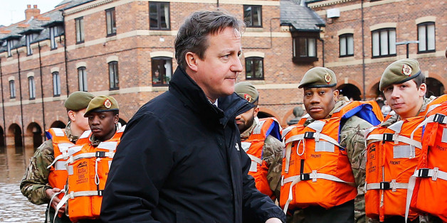 Prime Minister David Cameron greets soldiers working on flood relief in York city centre after the river Ouse burst its banks in North Yorkshire.