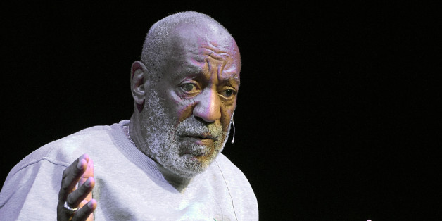 FILE - In this Friday, Nov. 21, 2014, file photo, comedian Bill Cosby performs at the Maxwell C. King Center for the Performing Arts, in Melbourne, Fla. Lawyers for Cosby say they will fight an attempt to require the comedian's wife to give a sworn deposition in a defamation lawsuit filed by seven women who have accused Cosby of sexually assaulting them decades ago. A lawyer for the women has subpoenaed Camille Cosby to be deposed on Jan. 6, 2016, at a Springfield hotel. (AP Photo/Phelan M. Ebenhack, File)