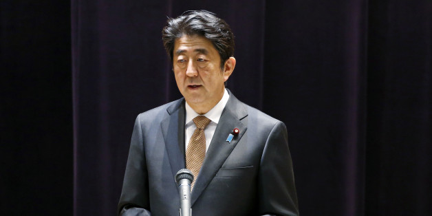 Japanese Prime Minister Shinzo Abe addresses the senior officers of Japan's self defense forces at the Defense Ministry in Tokyo, Wednesday, Dec. 16, 2015. (AP Photo/Shuji Kajiyama)