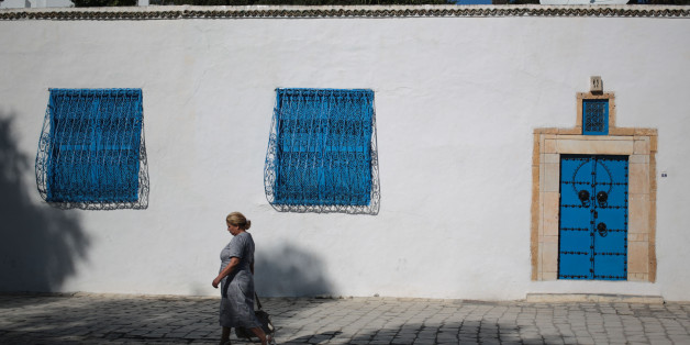 A woman walks in the city of Sidi Bou Said, 20 km north of Tunis, Tunisia, Saturday, Oct. 24, 2015. (AP Photo/Mosa'ab Elshamy)