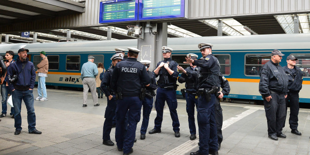 Police wait for the arrival of refugees at the main train station in Munich, Germany, Monday, Sept. 7, 2015. Refugees arrived in various trains to get first registration as asylum seekers in Germany.  (AP Photo/ Kerstin Joensson)
