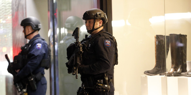 New York police officers patrol Madison Avenue during New Year's Eve celebrations, Thursday, Dec. 31, 2015, in New York. Nearly 6,000 armed police officers are guarding Times Square as the year 2015 draws to a close. (AP Photo/Julio Cortez)