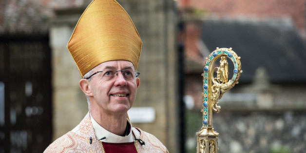 The Archbishop of Canterbury, Justin Welby, arrives at the west door to  deliver his Christmas Day sermon to the congregation at Canterbury Cathedral on December 25, 2015.