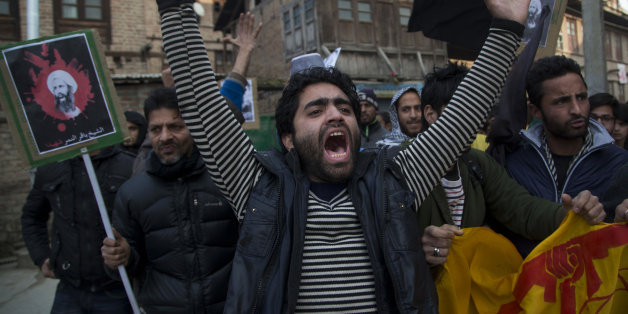 A Kashmiri Shiite Muslim man shouts slogans against the execution of Sheikh Nimr al-Nimr, during a protest in Srinagar, Indian controlled Kashmir, Saturday, Jan. 2, 2016. Hundreds of Shiite Muslims in Indian portion of Kashmiri rallied in the Shia dominated areas protesting against Saudi Arabia, after they announced on Saturday it had executed 47 prisoners convicted of terrorism charges, including al-Qaida detainees and a prominent Shiite cleric who rallied protests against the government. (AP P