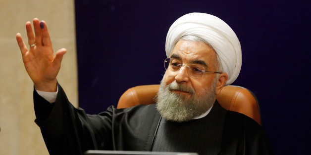 Iranian President Hassan Rouhani addresses a press conference after registering his candidacy for the upcoming Assembly of Experts elections at the interior ministry in Tehran on December 21, 2015. The 86-member Assembly's role is to monitor the work of the supreme leader, currently Ayatollah Ali Khamenei. The poll will coincide in February 2016 with parliamentary elections, which could see more moderates and reformists chosen on the back of Iran's recent nuclear deal with world powers. AFP PHOTO / ATTA KENARE / AFP / ATTA KENARE        (Photo credit should read ATTA KENARE/AFP/Getty Images)