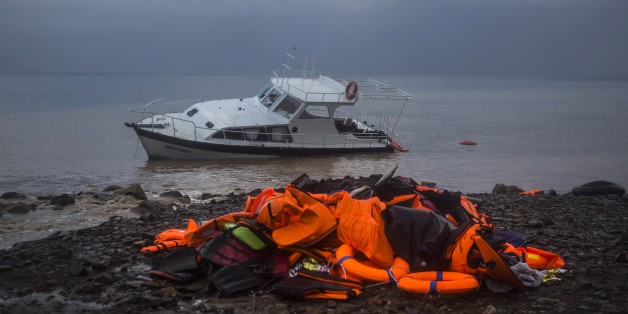 Life Jackets and a boat used by refugees and migrants to cross a part of the Aegean sea from Turkey to the Greek island of Lesbos remain on a beach, Thursday, Nov. 26, 2015. About 5,000 migrants reaching Europe each day over the so-called Balkan migrant route. The refugee crisis is stoking tensions among the countries on the so-called Balkan migrant corridor — Greece, Macedonia, Serbia, Croatia and Slovenia. (AP Photo/Santi Palacios)