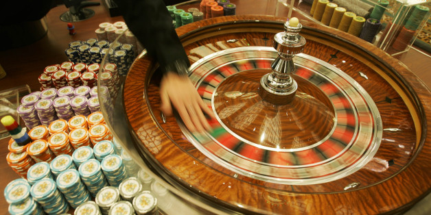 "**ADVANCE FOR WEEKEND EDITIONS, MARCH 3-4** FILE ** A staff member shows photographers the gambling tables at the new casino ""Grand Lisboa Casino"" in Macau in this Feb 11, 2007 file photo. Macau - the only place in China where casinos are legal - says it's just getting started. More casinos, malls, convention centers, resorts and thousands of hotel rooms are being built in the city - about one-sixth the size of Washington, D.C.  (AP Photo/Kin Cheung, file)"