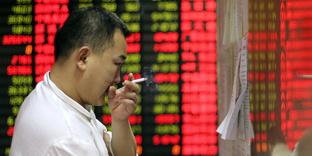 An investor checks market news on a board at a private security company Wednesday, April 9, 2008 in Shanghai, China. Chinese stocks tumbled Wednesday, with the benchmark Shanghai Composite Index shedding 5.5 percent as jittery investors unloaded shares in an afternoon sell-off. The 198.63-point decline in the Shanghai index, to 3,413.91, capped a three-day streak of advances that brought share prices back from one-year lows hit last week. (AP Photo)