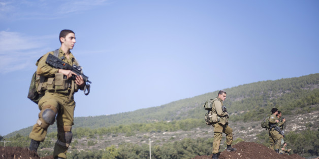 Israeli soldiers of the Golani brigade search for rockets fired from Lebanon after they landed in northern Israel, Monday, Dec. 21, 2015. sraeli officials say there's no damage or injuries after three rockets were fired into Israel from Lebanon last night. Hezbollah officials had pledged to avenge the killing of a Lebanese man killed by an Israeli airstrike on the Syrian capital Saturday night. (AP Photo/Ariel Schalit)
