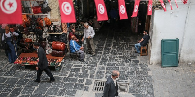 People walk through the Medina market in Tunis, Tunisia, Monday, Oct. 26, 2015. (AP Photo/Mosa'ab Elshamy)
