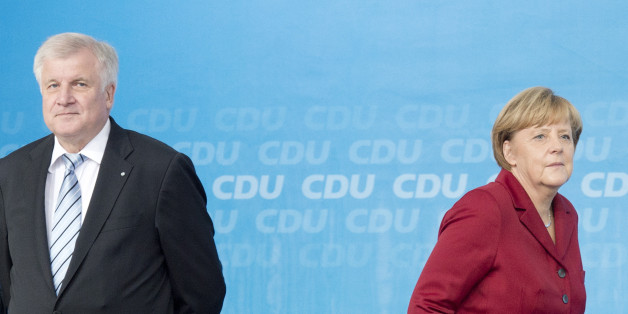 German Chancellor Angela Merkel walks besides Horst Seehofer,, left,  governor of Bavaria and chairman of the CSU, during an election campaign event of the German Christian Democratic Union (CDU) in Fulda, Germany, on Thursday, Sept. 19, 2013. Merkel, the leader of the conservative Christian Democratic Union party (CDU) and top candidate of her party will be challenged by Social Democratic Party (SPD) top candidate Peer Steinbrueck at Germany's general elections on Sept. 22, 2013. (AP Photo/Jens Meyer)