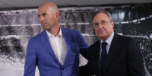 Real Madrid's President Florentino Perez, right, stands with newly appointed coach Zinedine Zidane at the Santiago Bernabeu stadium in Madrid, Spain, Monday Jan. 4, 2016. Real Madrid has fired coach Rafael Benitez after seven months and replaced him with former player Zinedine Zidane a day after Madrid's 2-2 draw at Valencia deepened a crisis that started with an embarrassing 4-0 home loss to rival Barcelona in November. (AP Photo)