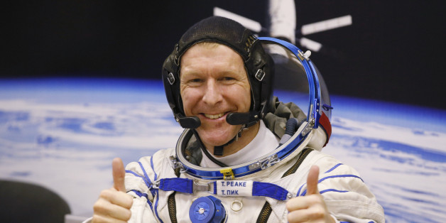 FILE - In this Tuesday, Dec. 15, 2015 file photo, British astronaut Tim Peake, member of the main crew of the expedition to the International Space Station (ISS), gestures prior the launch of Soyuz TMA-19M space ship at the Russian leased Baikonur cosmodrome, Kazakhstan. Anyone can dial a wrong number, but its not often done from outer space. Peake tweeted an apology on Christmas Day from the International Space Station after calling a wrong number. (AP Photo/Dmitry Lovetsky, File)